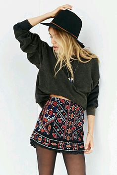 Embroidered black skirt, oversized gray sweater, black floppy hat