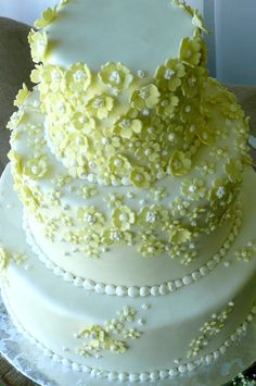 Cascades of Yellow Flowers Wedding Cake - Time Consuming but worth it! Absolutely fresh and lovely