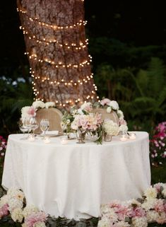 Bride and Groom Table in Garden   photography by http://www.giacanali.com/   floral design by http://flowerwild.com/