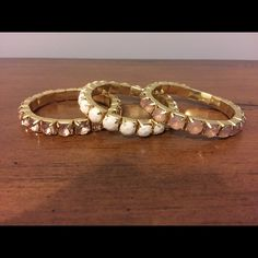 NWOT Set of 3 Bracelets NWOT Two different shades of pink and one white stretchy gem bracelets. A perfectly coordinated arm party! Looks brand new because it is! Jewelry Bracelets