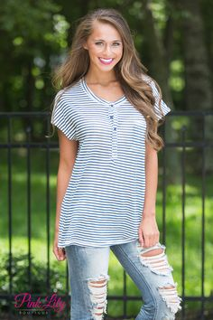 Whether walking around town or relaxing at the lake, this sweet striped blouse is perfect for staying comfortable all summer long! Featuring dark blue and off-white stripes on a slightly textured and soft fabric, it's a classic style that will last for many seasons! It has a scoopneck, cute short sleeves, a pocket, and buttons in front.