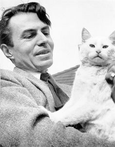 James Mason et son chat. Siamese Cats, Cats And Kittens, Snowshoe Siamese, I Love Cats, Cool Cats, Nine Cat, Celebrities With Cats, Celebs, Men With Cats