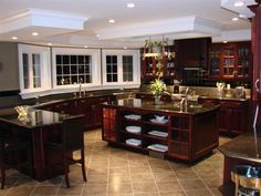 Pretty close to my dream kitchen at tad to modern fir me but I love the shape and vastness.