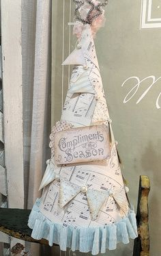 vintage Christmas tree, if your going to use sheet music in your wedding decor, and you have your wedding during the holidays, this would be great centre pieces. there are lots of ideas. check out all the ideas to use with the pages of books and just swap idea for sheet music