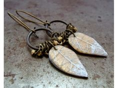 Humblebeads Blog: 20 Earring Inspirations Frosted Leaf Charms mixed with jump rings and faceted brass beads.