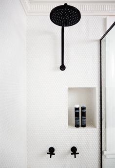 Bathrooms with black shower fixtures, showers with white tiles, minimalistic bathroom design Laundry In Bathroom, Bathroom Renos, Bathroom Interior, Small Bathroom, Master Bathroom, Bathroom Black, White Mosaic Bathroom, Basement Laundry, White Bathrooms