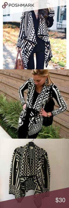 Aztec Print Cardigan Black and White Aztec print cardigan. Adorable bold print with waterfall style cardigan opening. Brand: Staring at Stars from Urban Outfitters. Urban Outfitters Sweaters Cardigans