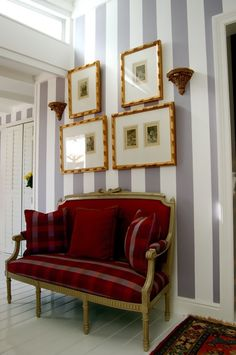 i love the bold stripes paired with the regal couch in red. we really want to mix eras like this. (: