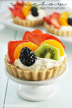 quite possibly one of the most beautiful, delicious, and EASIEST fancy desserts on the planet to make. Save time and use Pillsbury Sugar Cookie Dough. # fancy Desserts Rainbow Fruit Tartlets - Something Swanky Fancy Desserts, Just Desserts, Delicious Desserts, Dessert Recipes, Yummy Food, Kraft Recipes, Pillsbury Sugar Cookie Dough, Fruit Tartlets, Fruit Pie
