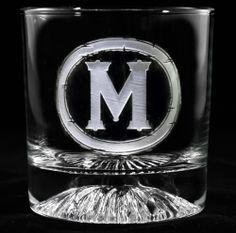 11oz single letter engraved whiskey glass gift. This single letter personalized design is bold and manly, perfect for your guy's mancave.  This no frills distinct design has a stong font inlaid in a circle with torn edges.  Makes a great gift for men.