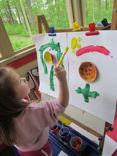 Cupcake wrappers on the easel = starting place for art. -- Teach Preschool