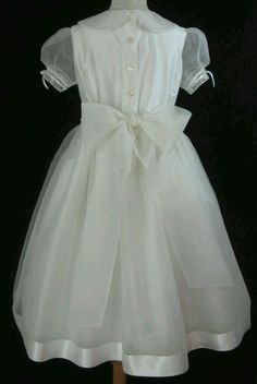 2b2df1cb039d Back view of Grace by Embroidered Heirlooms. Girls First Communion Dresses