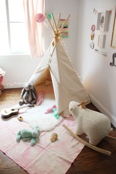 Sweet playroom for a little one – love the soft, pastel colour scheme. By Chloe Fleury | 10 Fun & Friendly Kids Playrooms ~ Tinyme Blog