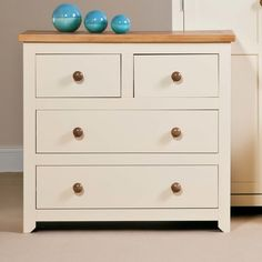 Featuring four drawers that are perfect for storing DVDs and games in your living room or clothes and accessories in your bedroom, this classic two-toned chest is sure to complement any scheme.