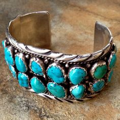 """Incredible SPENCER Navajo Sterling Turquoise Cuff An Amazing Vintage Beauty!! A woppin 95.5g!, 7"""" Around inside with just over another inch I the opening! Great for a larger wrist or anyone that like a big look! Cuff is 1.5"""" Wide and 2.75"""" Across, Natural Turquoise Cabochons are Scalloped Bezel Set and are approx. 10x-2mm each. Stones are magnificent, vary in beautiful Blue color and copper/brown matrix. Marked Spencer and Sterling, Vintage Navajo Jewelry Bracelets"""