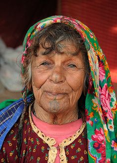 Bedouin woman with tattoed face, Bedouin camp on the edge of the Sahara (near Douz), Tunisia by iancowe, via Flickr