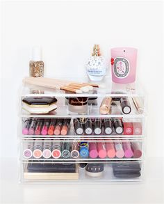 I am obsessed with clear make up storage solutions like this MUJI drawer. The beauty products are perfectly laid out and the upcycled Diptyque pink candle jar is gorgeous #upcycling