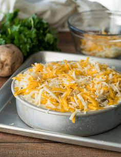 Once the potatoes are cooked in the Instant Pot, remove the pan and place on a baking sheet. Top with cheese and pop under the broiler for a few minutes.