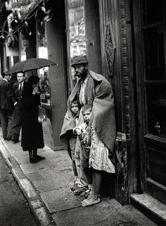 Begging on the streets of Madrid, 1940 by Hermes Pato - In this abundant world... there seems to be enough for all, yet....