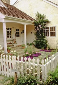 Cottage style courtyard garden with white   picket fence. I want this for my little dog yard.