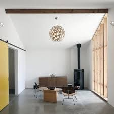 SHED Architecture & Design turned an unused stable into a flexible studio/office space that could also work as a guest space for visitors. Cottage Lighting, Barn Style Doors, Cheap Wall Decor, Horse Stables, Building A Shed, Guest Suite, Architecture Design, House Design, Interior Design