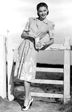 WE ♥ THIS!  ----------------------------- Original Pin Caption: Ava Gardner in the 1940s wearing a short-sleeve midi dress