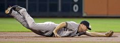 Just missed it  -         New York Yankees third baseman Chase Headley dives for a single hit by Houston Astros' George Springer during the first inning on June 28 in Houston.    -  © David J. Phillip/AP Photo