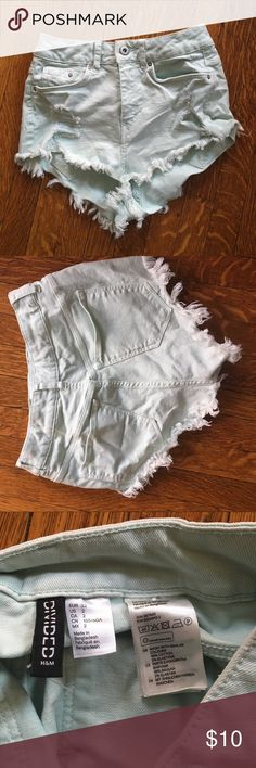 Mint cut off booty shorts H&M cut off shorts, def peaky booty shorts. Rips in the front. Super cute and fun! Divided Shorts Jean Shorts