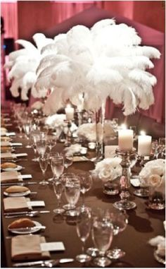 Room Layout - Table Setting and Ostrich Feather Centrepiece - with gold tablecloth and matching table napkins
