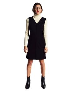 Vintage 1990s black merino wool dress with ribbed cream turtleneck and sleeves. Two patch pockets. Slip on. Label: Jones New York Dress Petite Fabric: 69% Acrylic, 31% Merino Wool Tag Size: P/P  Modern Fit: XS - M Shoulders: 15.5 Sleeves: 23.5 Bust: 36 flat - 39 stretched Hips: 38 flat - 41 stretched Total Length: 34  CONDITION Excellent vintage condition.