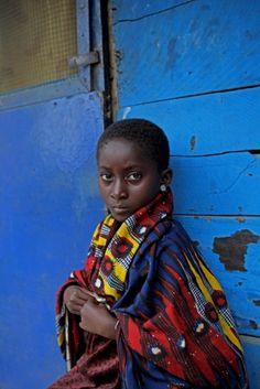 Love the beauty in this photo. Beautiful woman/child, beautiful fabric, beautiful blue background!