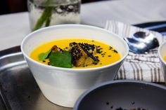 Miso ginger pumpkin soup with black sesame croutons