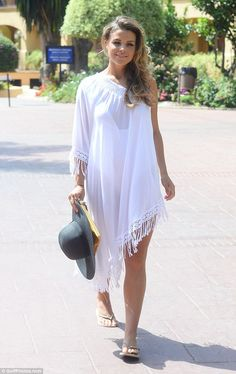 Beach to pool: Chloe added a chic white kaftan to the beach look to transfer her outfit to...