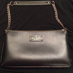 Kay Spade Clutch With Shoulder Strap Very gently used. No wear on outside. No major stains on inside. Please ask if you want more pictures! kate spade Bags Shoulder Bags
