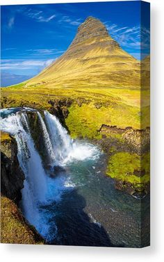 Iceland Canvas Print for sale. One of the most amazing places on earth: Kirkjufellfoss waterfall with Kirkjufell mountain, a dream landscape in green, yellow and blue with lots of water. Snaefellsness, Iceland. The image gets printed on one of our premium canvases and then stretched on a wooden frame, click through and check out your options. 30 days money back guarantee. Matthias Hauser - Art for your Home Decor and Interior Design.