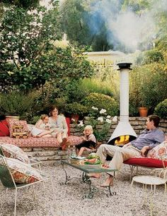 great seating plan and stone wall for fire pit area