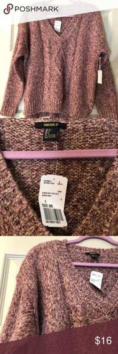 🆕FOREVER 21 Burgundy Cable Knit V-Neck Sweater light burgundy color w/ white in it new with tags slightly fuzzy knit fits true to size has small slots on the bottom sides of the sweater for the perfect fit!! pairs well with jeans or black pants Forever 21 Sweaters V-Necks