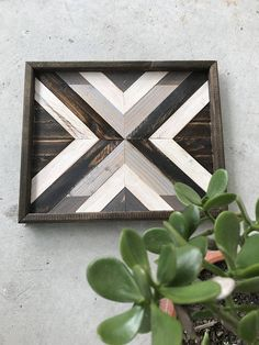 Handmade Geometric Wood Art. Each piece is stained, cut, and arranged to create an eye-catching pattern to enhance any space. Perfect for a housewarming, anniversary, Christmas, wedding, or birthday gift! • Piece measures approximately 13 x 16 inches. • Hanging hardware included, so