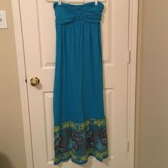 strapless blue maxi dress! This blue maxi dress features a scrunched back with a paisley detailing around the bottom!! Kept in great condition!! Also have this dress in black in a separate listing!! Xhilaration Dresses Maxi
