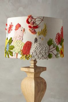 Embroidered birds bestow whimsy and playful character to Anthropologie's Cockatoo shade; $148 | archdigest.com