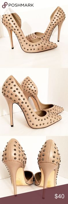 """Studded Pumps There's no nonsense when it comes to the fierce studded styling of this pointed-toe pump by Izabella Rue. •5"""" heel • All studs intact. • no modeling • no trades •ALL PHOTOS (EXCLUDING MODEL) ARE OF THE ACTUAL SHOES YOU WILL RECEIVE SHOULD YOU DECIDE TO PURCHASE Izabella Rue Shoes Heels"""
