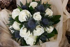 bridal bouquet idea - white roses & Scottish thistles