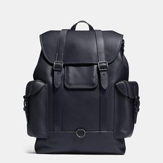 An example of the ultimate expression of fine form and exceptional function, our handsome new Gotham Backpack is crafted in glovetanned leather reinforced with workwear rivets and heavy topstitching in a pop color. We've packed it with clever features for the modern man, including quick-release magnetic closures under the buckles, a tech pocket with a hole for headset and charger cords, a secret side entry for easy access and an interior laptop compartment.