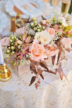 blush and cream floral centerpiece: not what I would have normally been drawn to, but these arrangements are stunning!  The contrasting textures and romantic colors make for such a feast for the eyes.