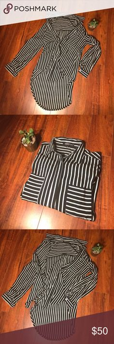 """LF Brand MIEEION long tunic button up size 8/M Incredibly sexy, loose fitting long button up tunic/shirt/dress from LF.  Black and white stripes with two chest pockets on either side, collar, button sleeves that can be pushed up, full button up front with fabric panel.  I got this at LF which has funky sizing, it is a size 8 but I wear it well and am a perfect medium.  EUC.  MEASUREMENTS: 32"""" long at longest point mid back. 41"""" around.  Meant to be worn loose and flowy or with a belt.  Or…"""