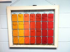 Paint Chip dry-erase calendar on an old window pane inspired by all the Pinterest paint chip calendar posts