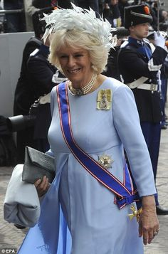 MailOnline:  The Duchess of Cornwall with her orders and sashes; she is wearing the Family Order of Queen Elizabeth  on her shoulder; the sash with cross insignia and star pin are part of the Grand Dame Cross of the Royal Victorian Order, personally awarded by Queen Elizabeth to the Duchess in 2012