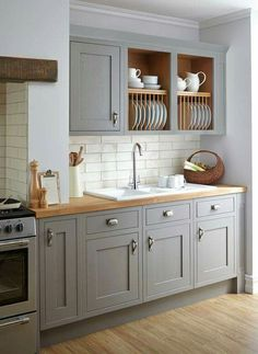 Butcher block counters with wood flooring gray cabinets