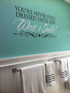 Updated our bathroom with this fun wall quote and Tiffany color blue walls!
