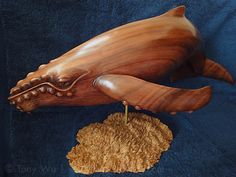 Wood Carvings of Sperm Whales and Humpback Whale